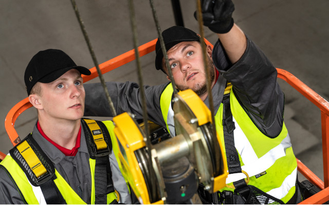 Two Street Cranexpress engineers servicing an overhead crane